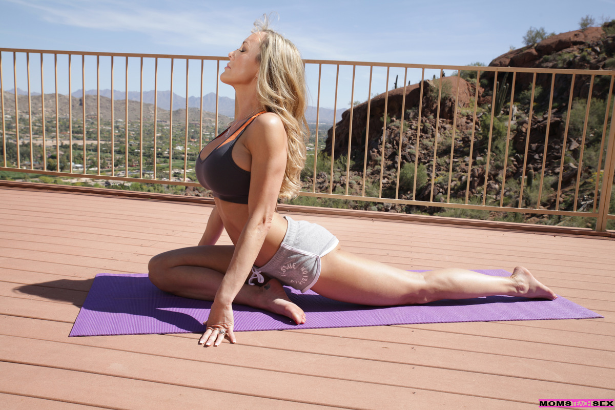 One of the sexiest milfs does yoga outdoors