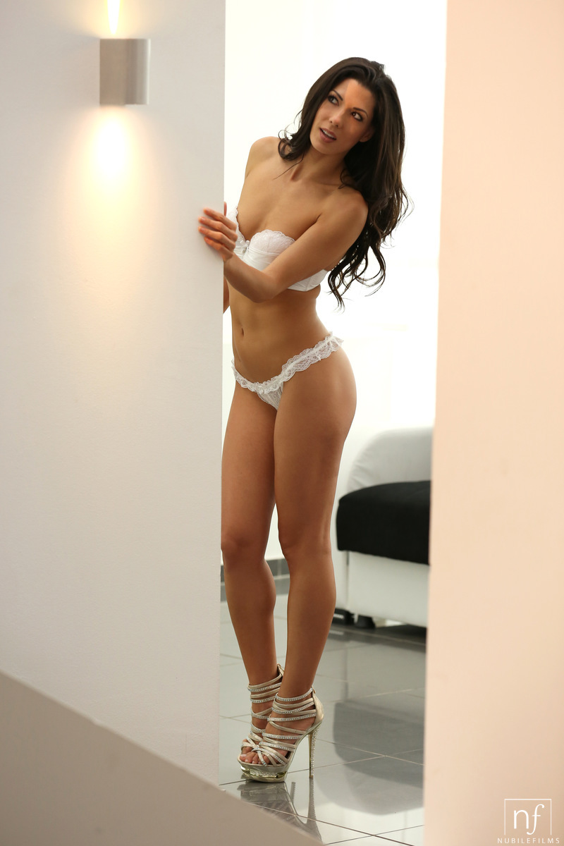 Perfect slim and tall brunette in heels and white lingerie
