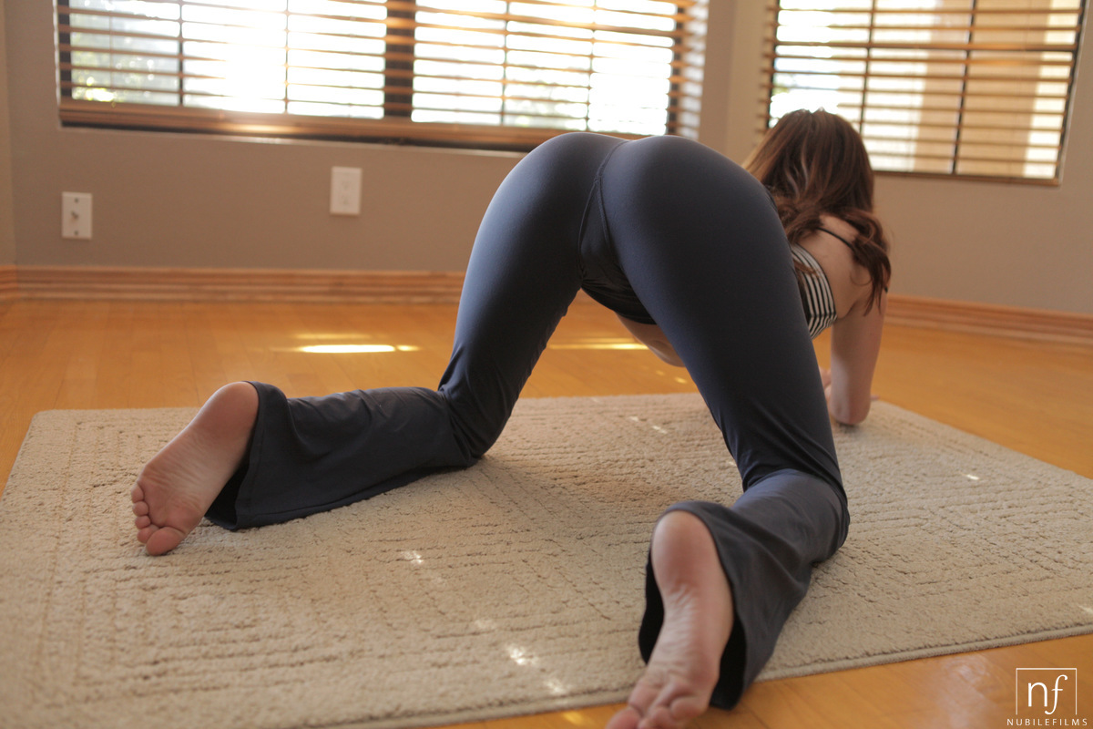Sexy flexible brunette doggystyle position with clothes