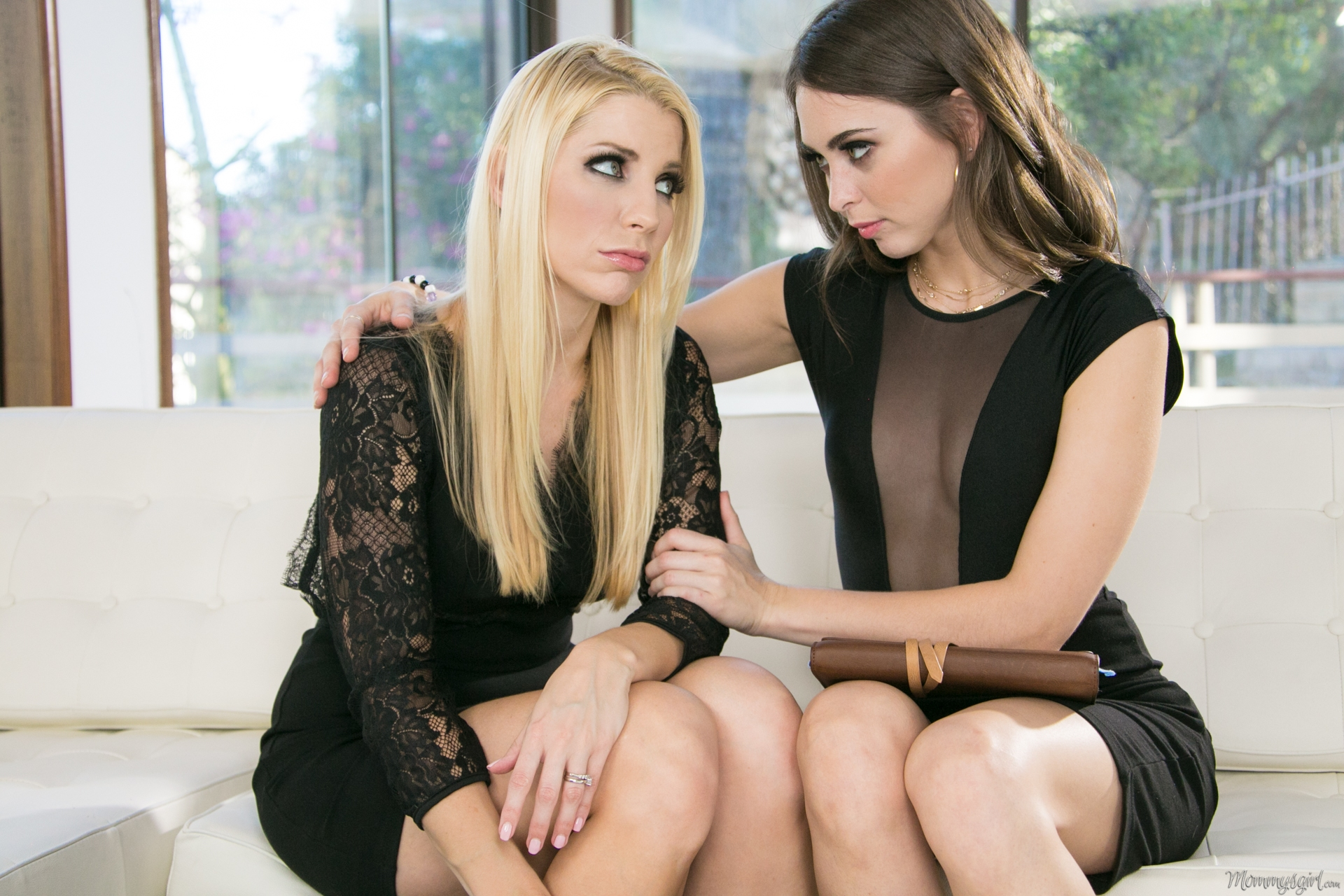 Perfect brunette and blonde in sexy black dresses