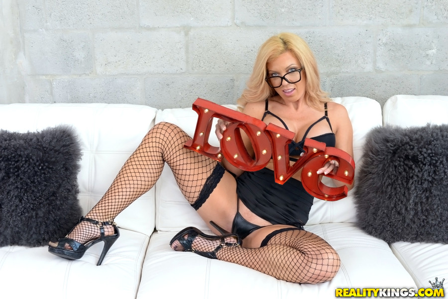 Sexy big titted blonde milf with black lingerie heels and glasses