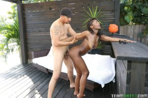 Sexy black girl fucked from behind by a white man