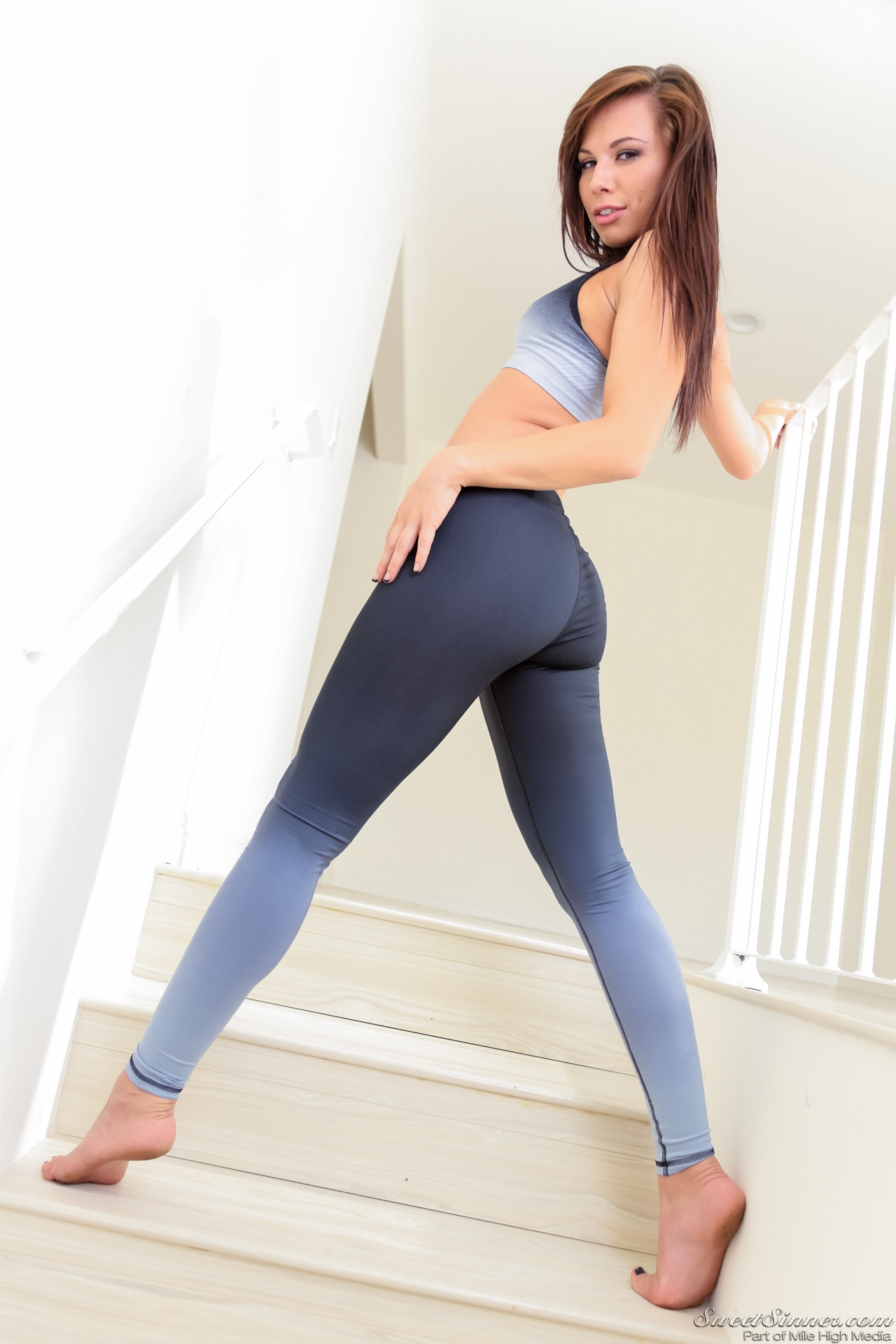 Sexy slim and tall brunette in yoga pants