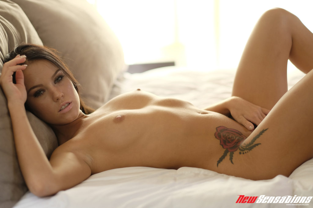 Perfect naked tan brunette on bed