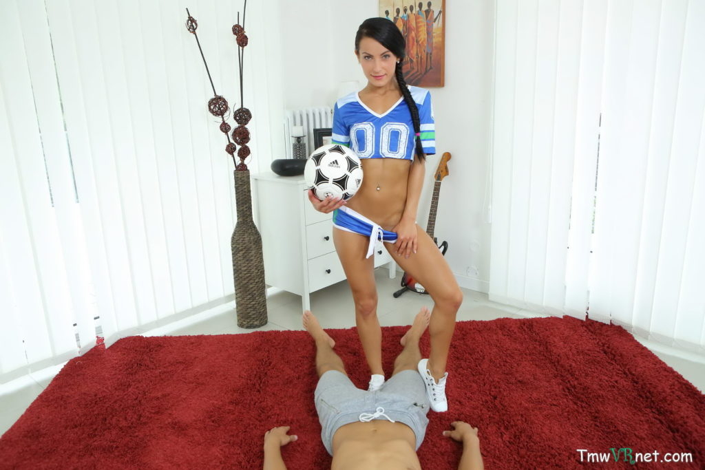 Sexy football cheerleader with a slim and tall body