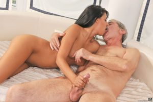 Super sexy young petite girl naked gives an old guy a handjob