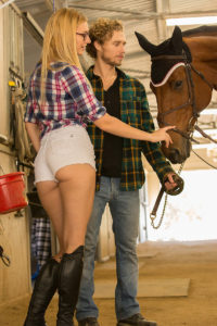 Sexy horse rider girl with a sexy ass